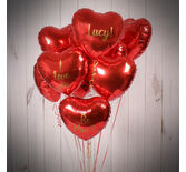 One Dozen Inflated Red Heart Foil Balloons